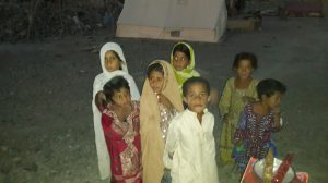 Baloch children waiting for assistance after the September 24, 2013 earthquake. Photo courtesy of the author.