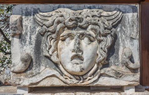 Part architrave with a frieze with mythical Gorgon Medusa head in ancient Temple of Apollo in Didim, Turkey