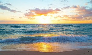 Sunrise over the ocean in Miami Beach, Florida. Spring sunrise at the empty beach.