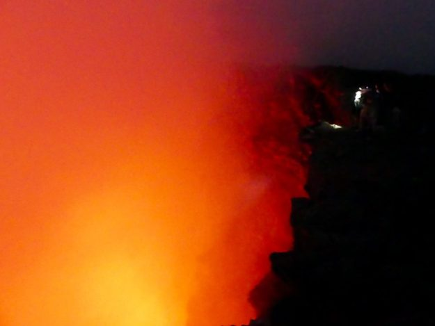 The smoky red haze obscuring our view of the lava pool
