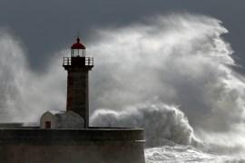 Huge wave over old lighthouse of Porto, Portugal