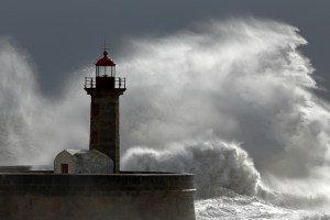 Huge wave over old lighthouse of Porto, Portugal
