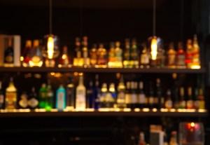 blur alcohol drink bottle at pub in dark night background