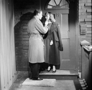 Shatner and Reid look kissy on the porch