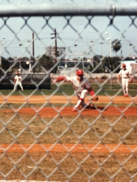 The author, pitching in a baseball game