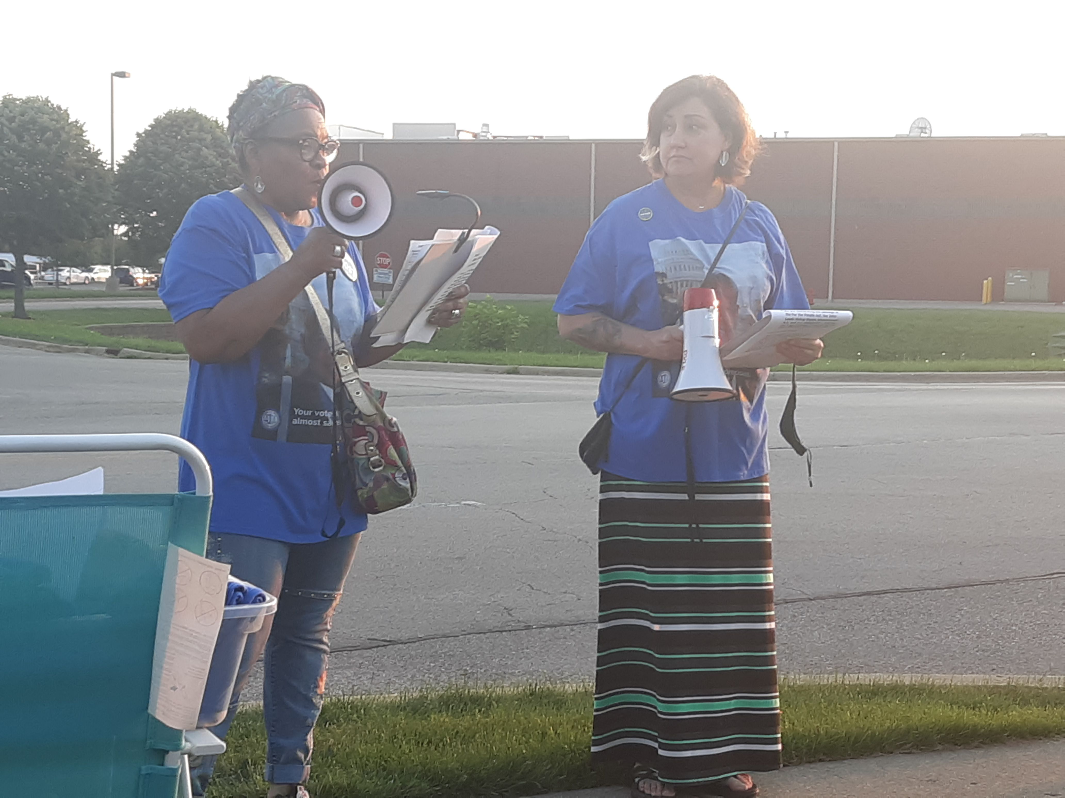 Eveej Malone, who organized a vigil Saturday night in honor of late Rep. John Lewis, speaks to a group of about 30 people gathered in Crystal Lake.