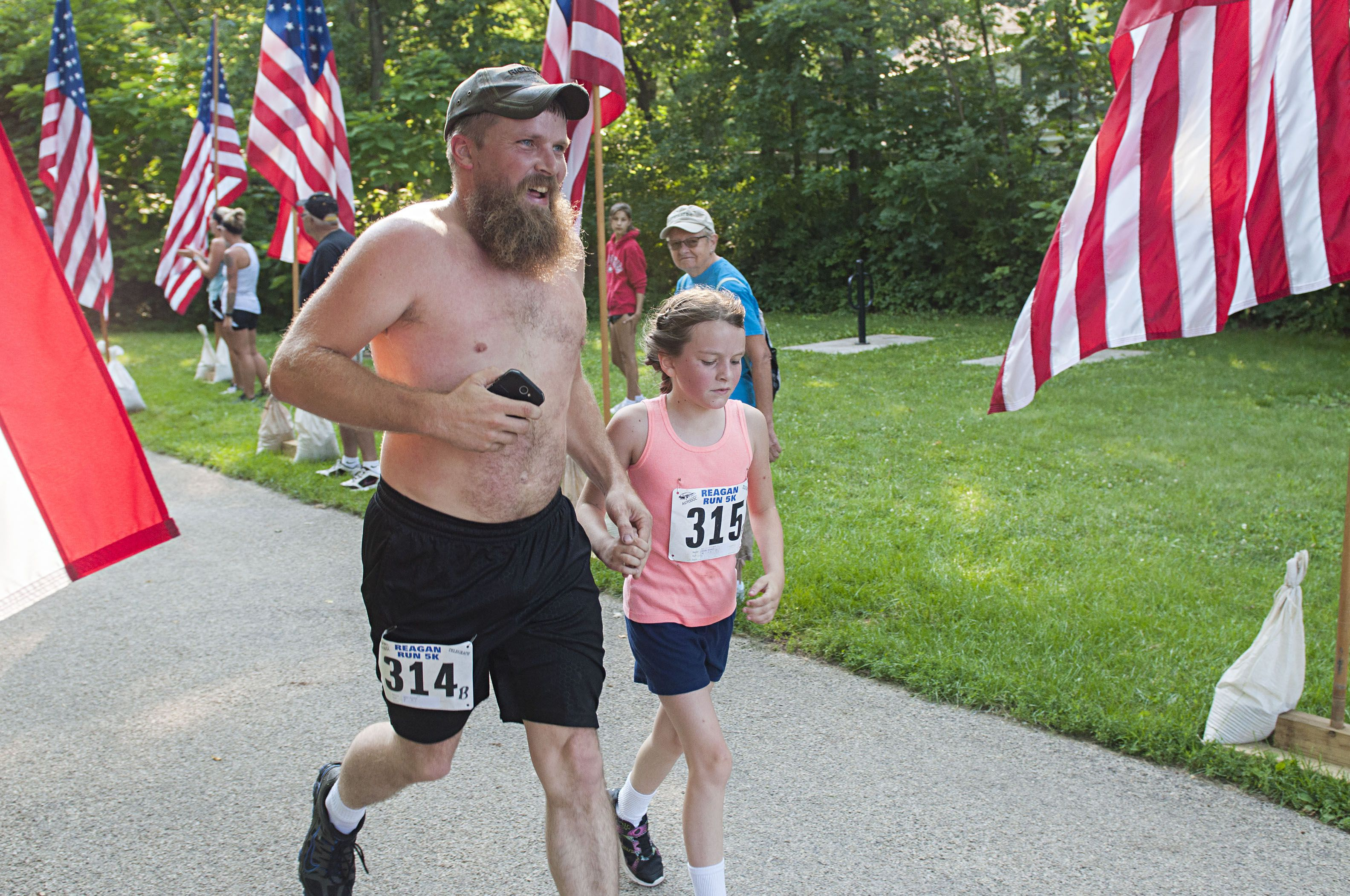 Jason Howlett crosses the line with his daughter Saturday. The two clocked a time of 33:41.