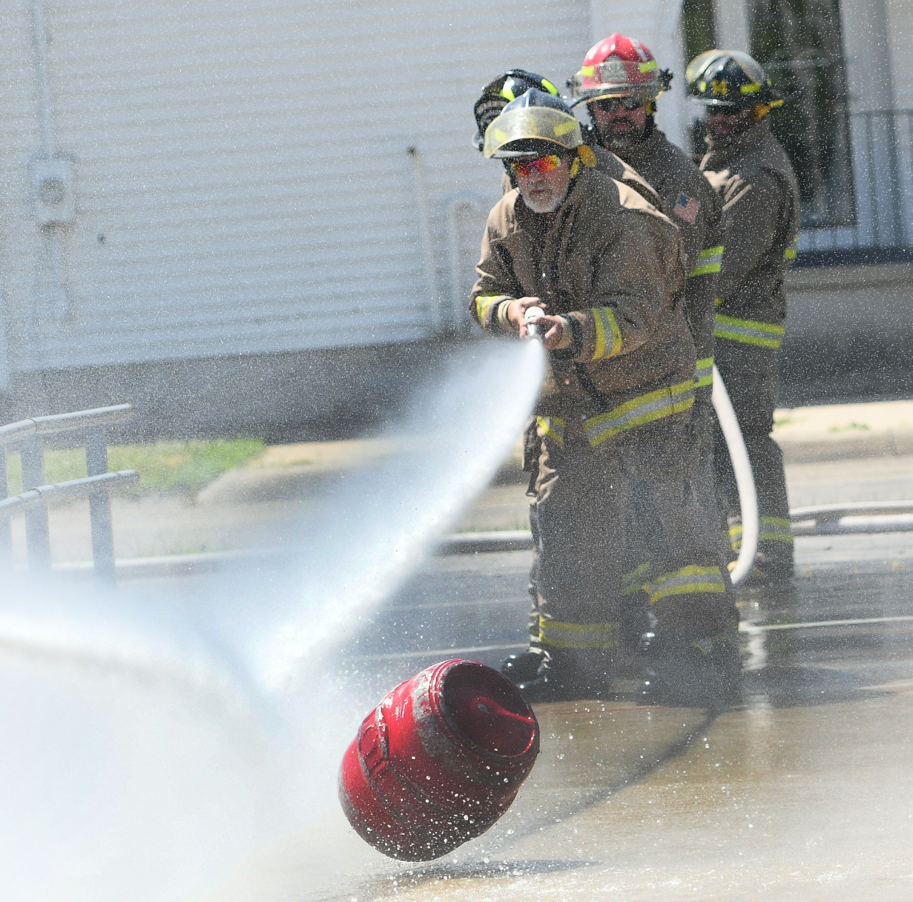 Hooppole firefighters Bill Hartman, Terry Sommers, Sheldon Miller, and Brad Rosenow compete Saturday.