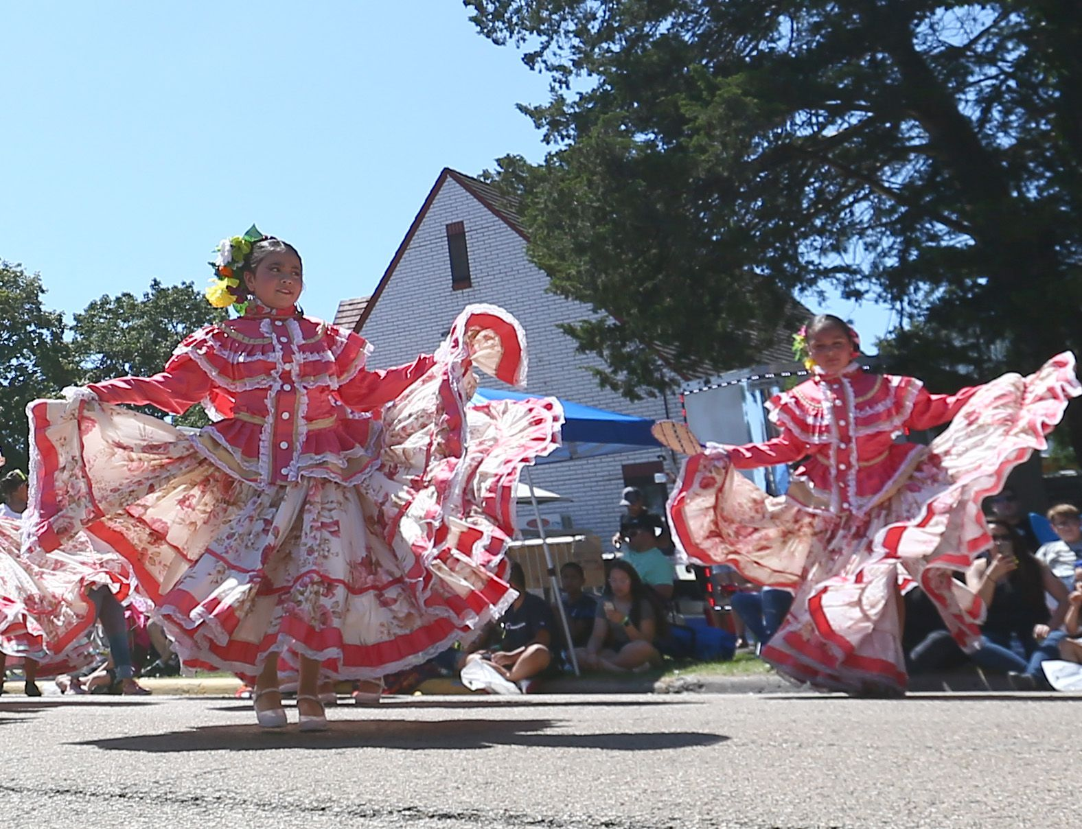 Women from the Ballet Folklorico De Colores dance during the during the 74th annual Sweet Corn Festival Parade in Mendota on Sunday Aug. 15, 2021.
