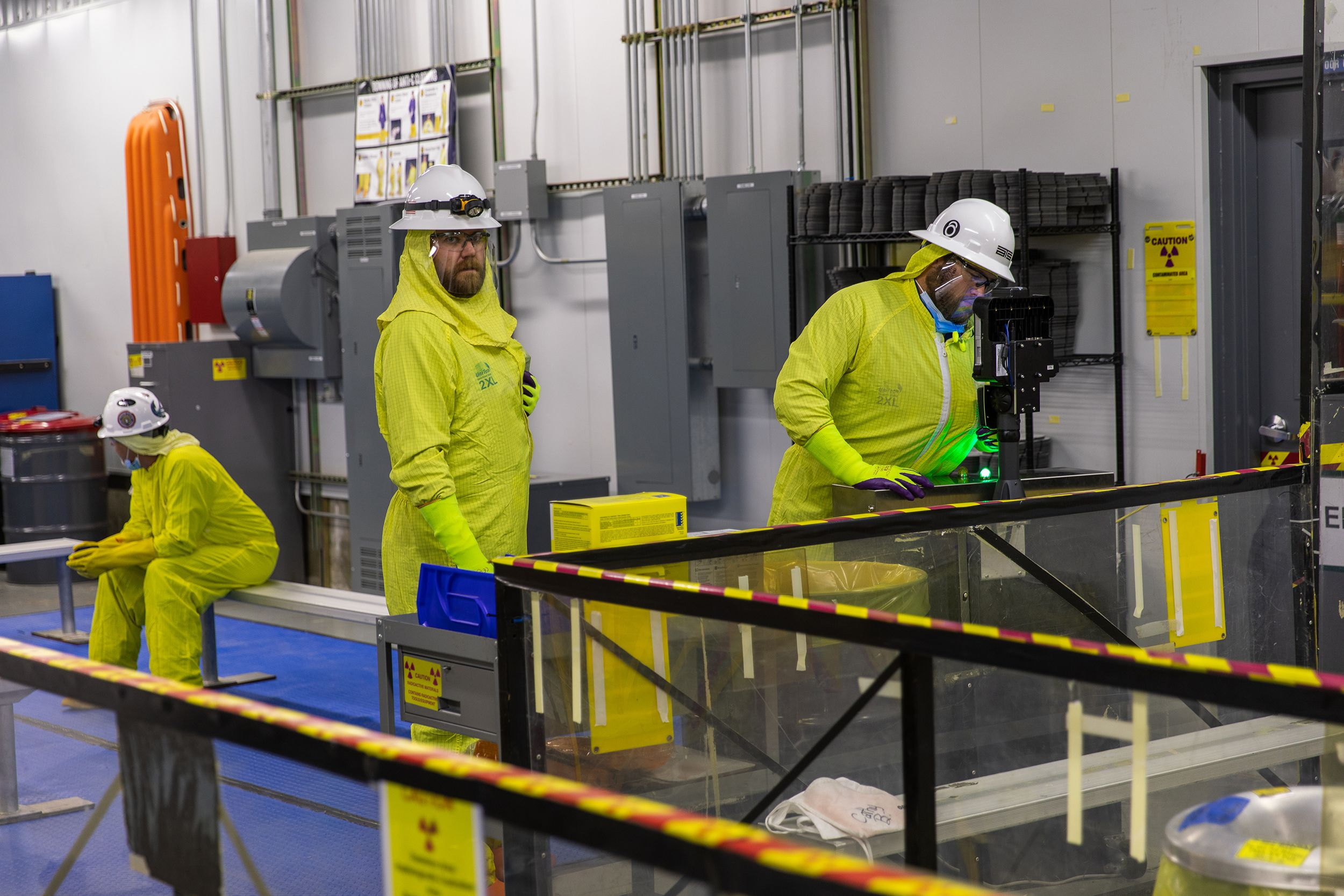 Workers prepare before going into the Unit 1 Containment Building during the Byron Station refueling outage. The Unit 1 reactor is located inside the containment building.