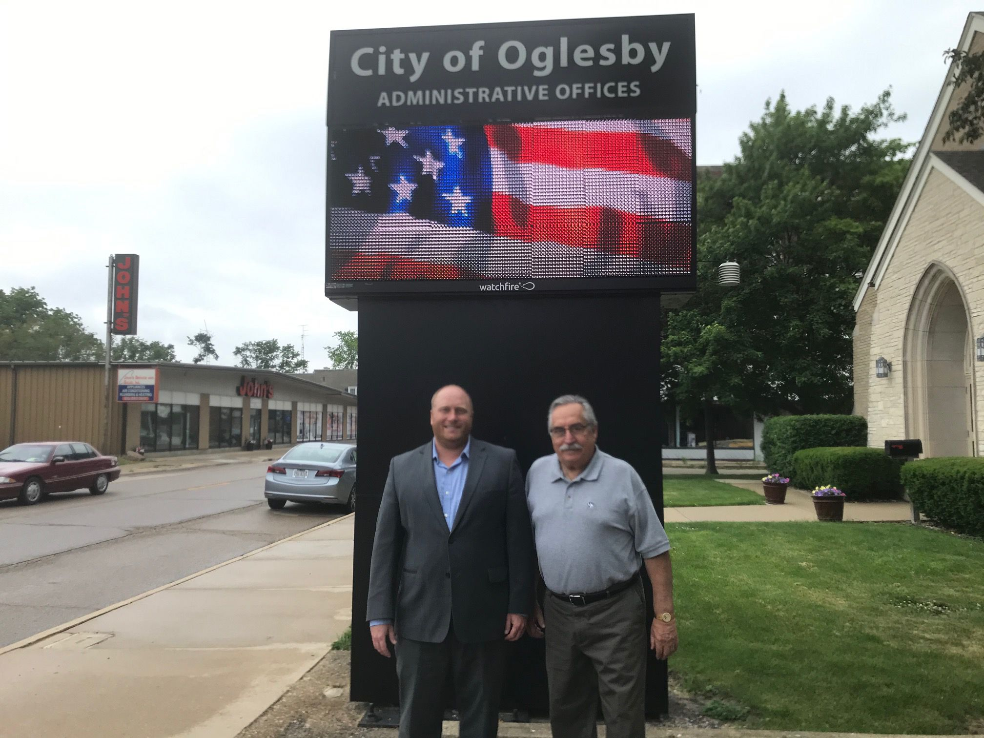 They have good reason to be smiling. Oglesby Commissioner Tom Argubright (left) and Mayor Dom Rivara opened their tax bills and found the city's property values increased, rates slid and the bottom line tumbled.