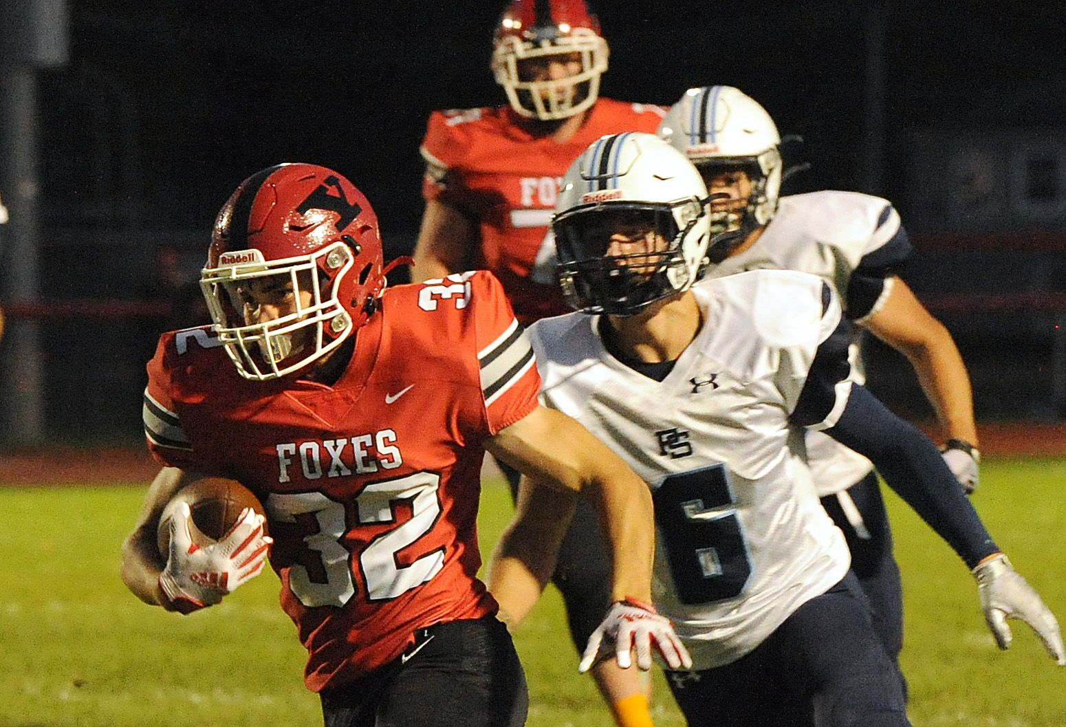 Yorkville runningback Gio Zeman (32) gets past Plainfield South safety Liam Drapeau on way to a touchdown during a varsity football game at Yorkville High School on Friday.