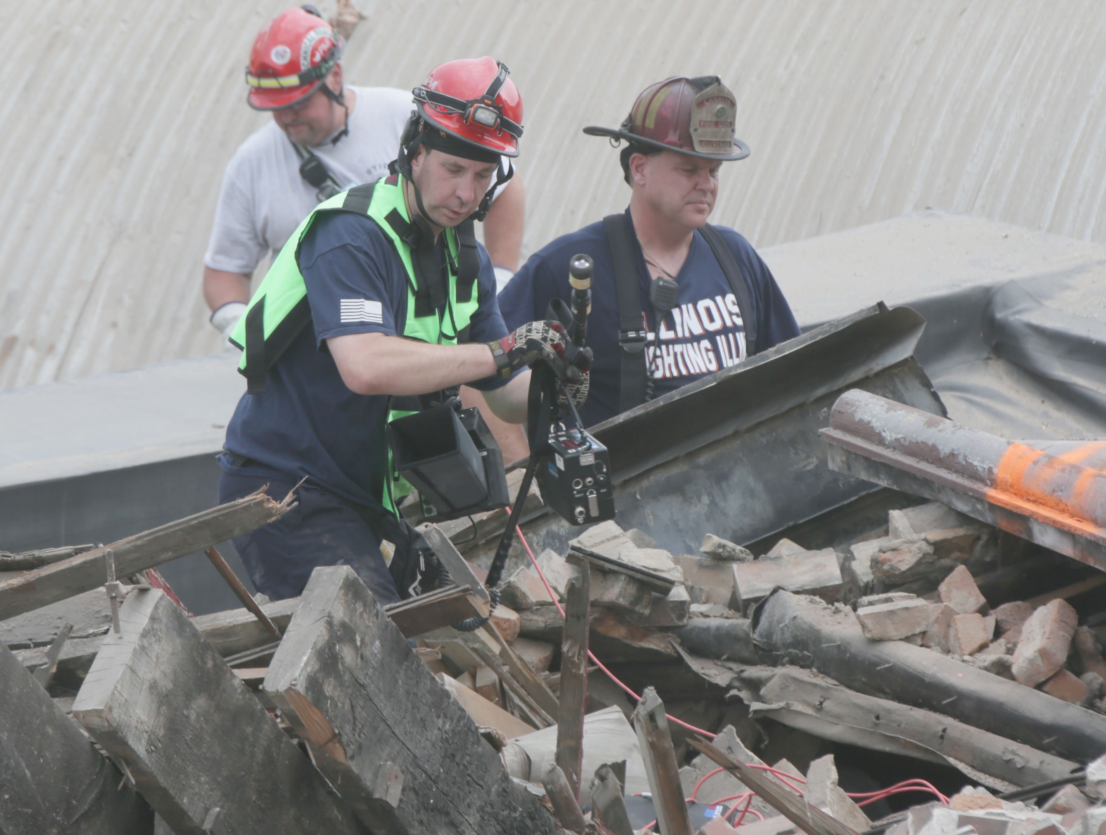 Utica firefighter James Didricksen, and other MABAS 25 members use a life detector while sifting through rubble at a partial building collapse located at 1001 First St. in downtown La Salle on Monday, July 19, 2021.