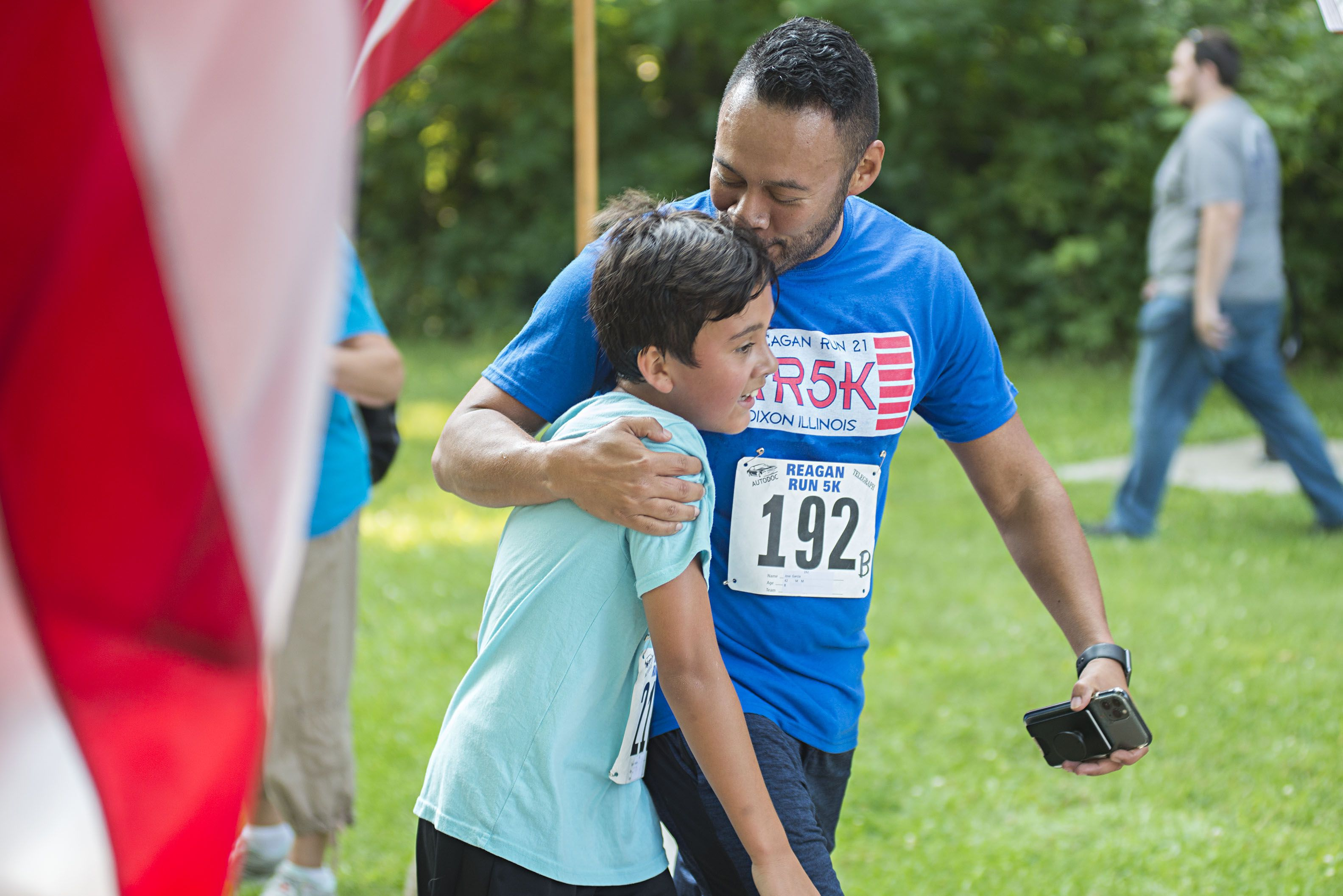 Jose Garcia kisses his son after the two complete their race Saturday in the 2021 Reagan Run.