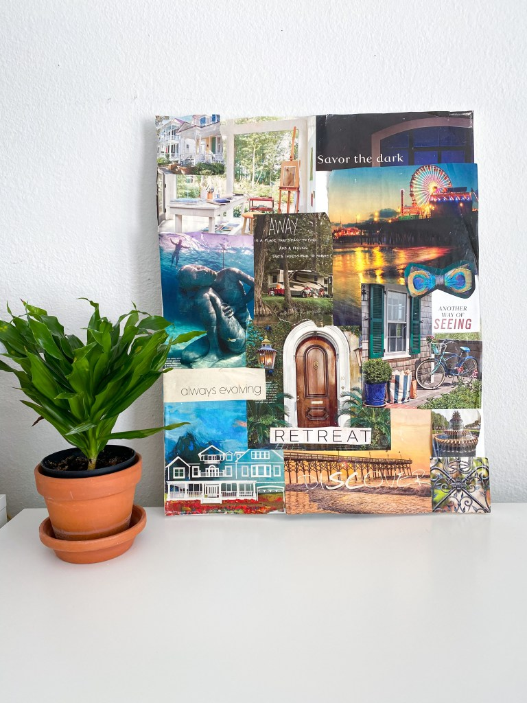 Magazine collage vision board with word of the year glued on canvas.