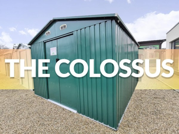 The Colossus Shed on the Sheds Direct Ireland showroom lot. It is tall, green and has a slight shine to it.