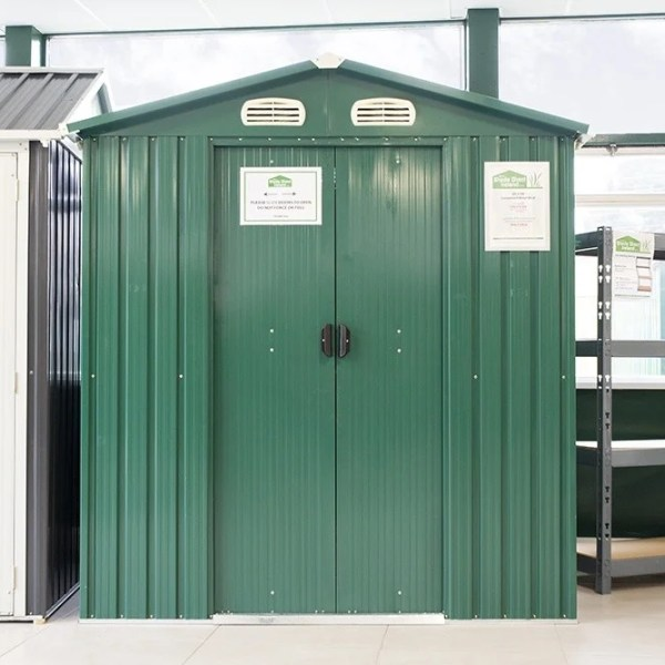 A front view of the Green, 6ft x 5ft Steel Garden Shed in the Sheds Direct Ireland Showroom