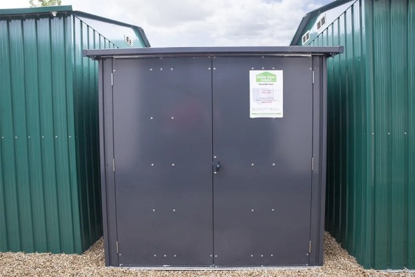 steel bike storage from sheds direct ireland. It is grey, with two doors, which are both closed. The view is from the front on, so you cannot see the depth.
