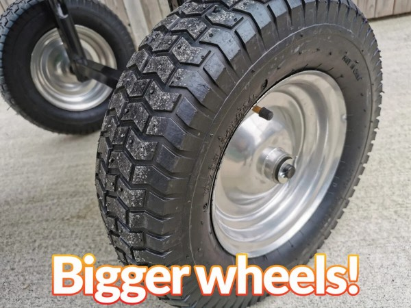 A close up photo of the two front wheels of the 250L tip cart. They are black rubber with a thick, shiny metal centre. There are thick, deep traction grooves on the outside of the tyres