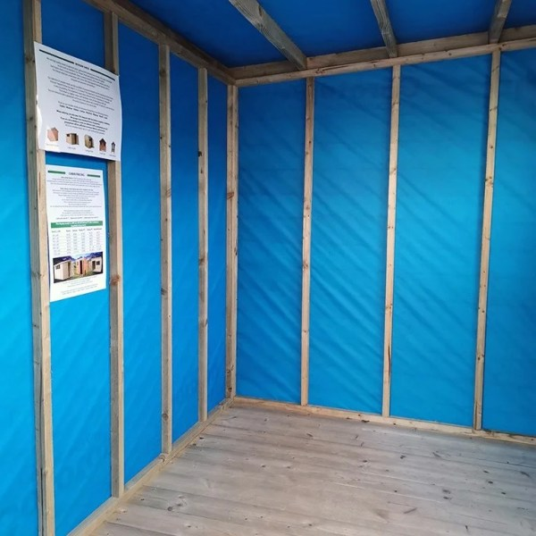 The internal membrane lining of the cabin shed. It is a bright, royal blue.
