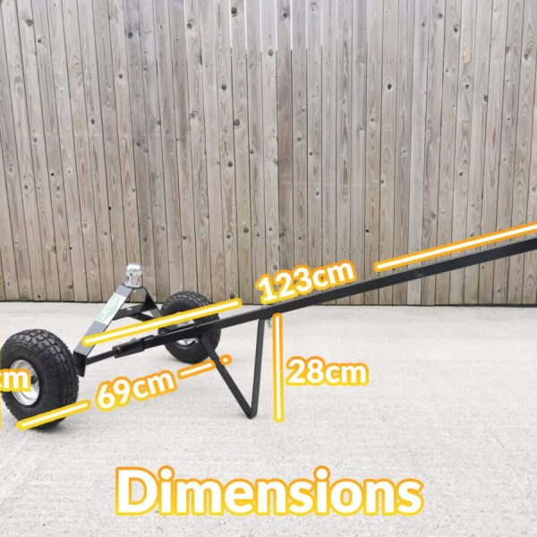 The Trailer Dolly with the Dimensions written on top. It is 123cm long, 69cm wide, the standing support bar is 28cm tall and the wheels are 25cm in diameter