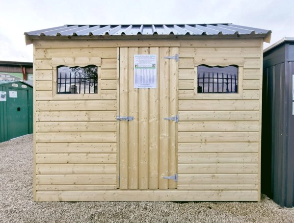 The 10ft x 6ft Wooden Cottage Shed with a steel roof on the Sheds Direct Ireland lot in Dublin.