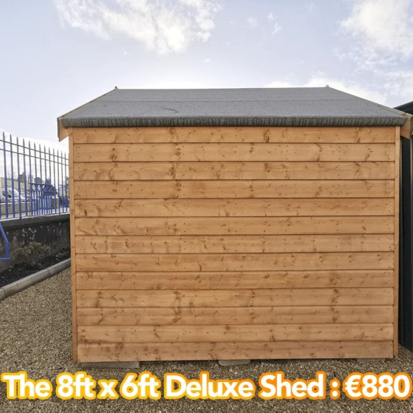 The 8ft x 6ft deluxe shed as seen in profile from outside. There are horizontally laid wooden planks and a black, felt roof.