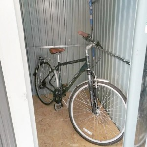 A man's mountain bike in the 4ft x 6ft steel shed standing upright.