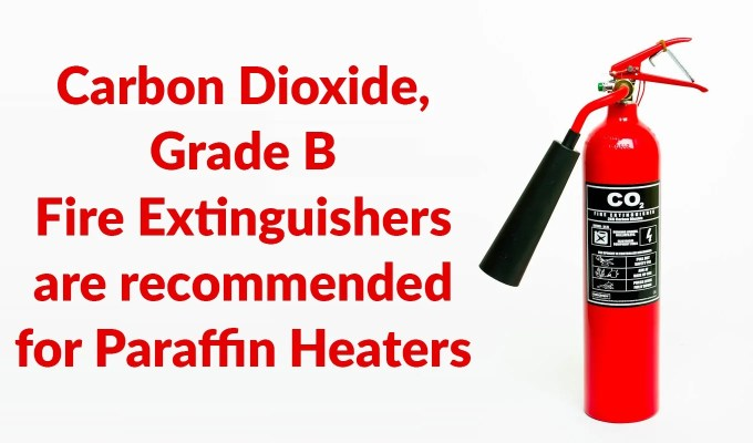 A picture of the recommended Fire extinguisher. It is red, with a black sign on it that reads 'CO2 Fire extinguisher'. It is against a white backdrop and the nozzle is pointing to the left.