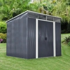 A grey and white Steel Pent shed on a large garden, with large, tropical looking trees in the background.