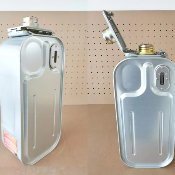 Spare tank inverter heater. Two of these tanks are stood side by side. They are long and rectangular in spare, but with smoothed corners. They are a light silver colour with a gold cap. There is a very feint rainbow tint to the gold cap. The one on the left is cloeed, however the one on the right has the cap open