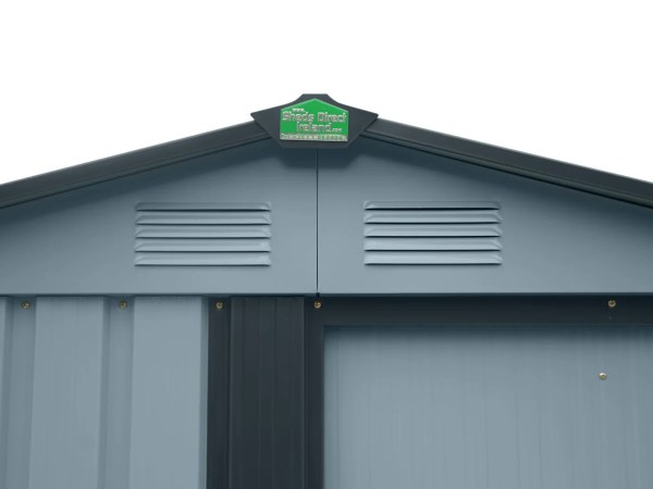 The Roof Cap of the Tiny Shed. It's dark grey with a green and reflective silver plate of the sheds direct ireland logo on it.