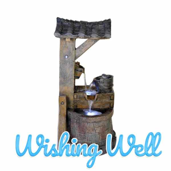 There is a wooden bucket sitting under a sheltered wishing well which is overflowing with water. The water is going from the wooden bucket, into a steel one and back around again.