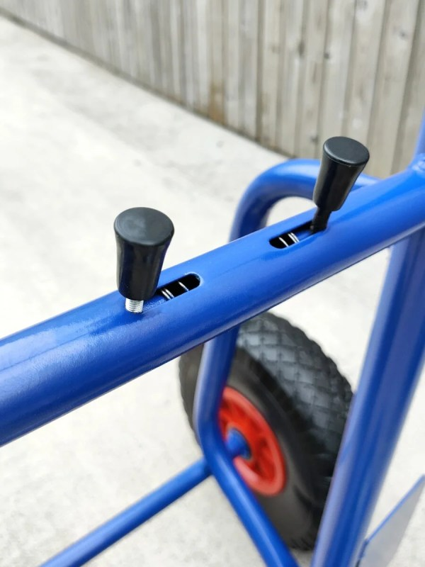 The compressible controls of the blue hand trolley which allow the movement of the back plate