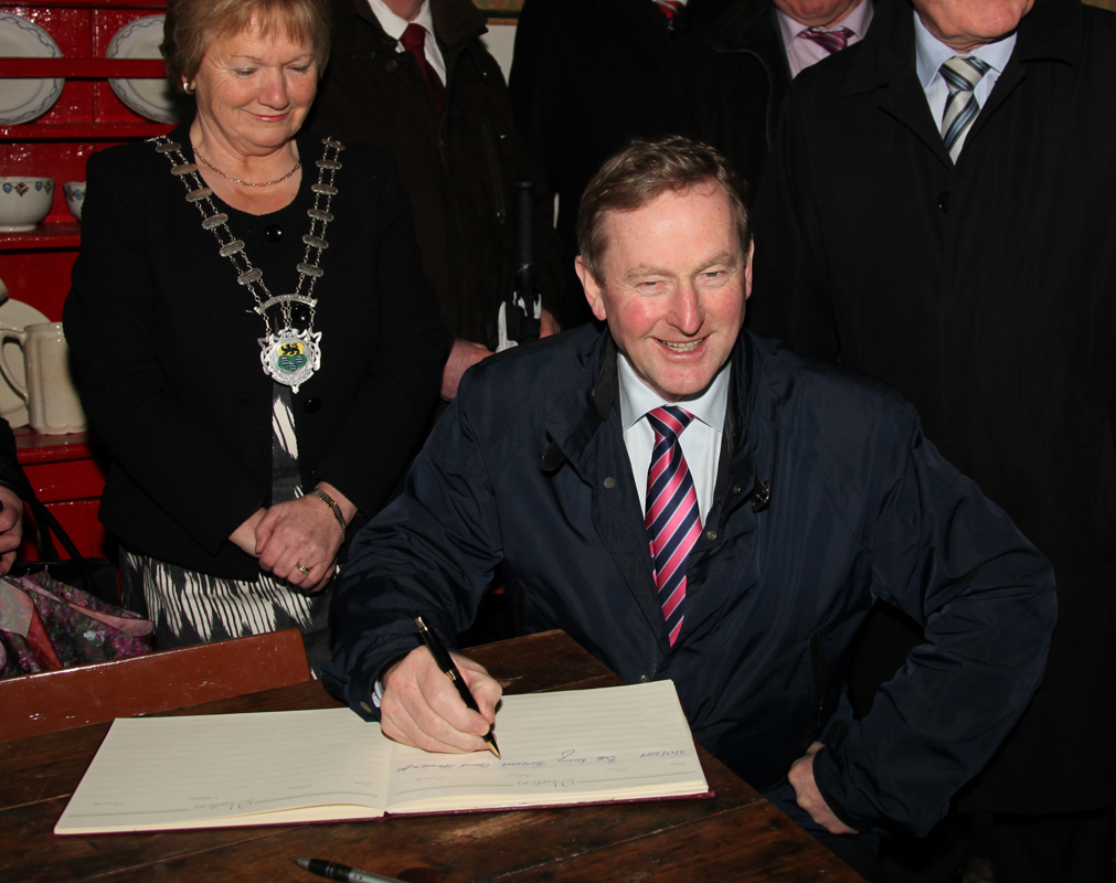 An Taoiseach Enda Kenny signing Visitors book in Sean Mac Diarmada's house