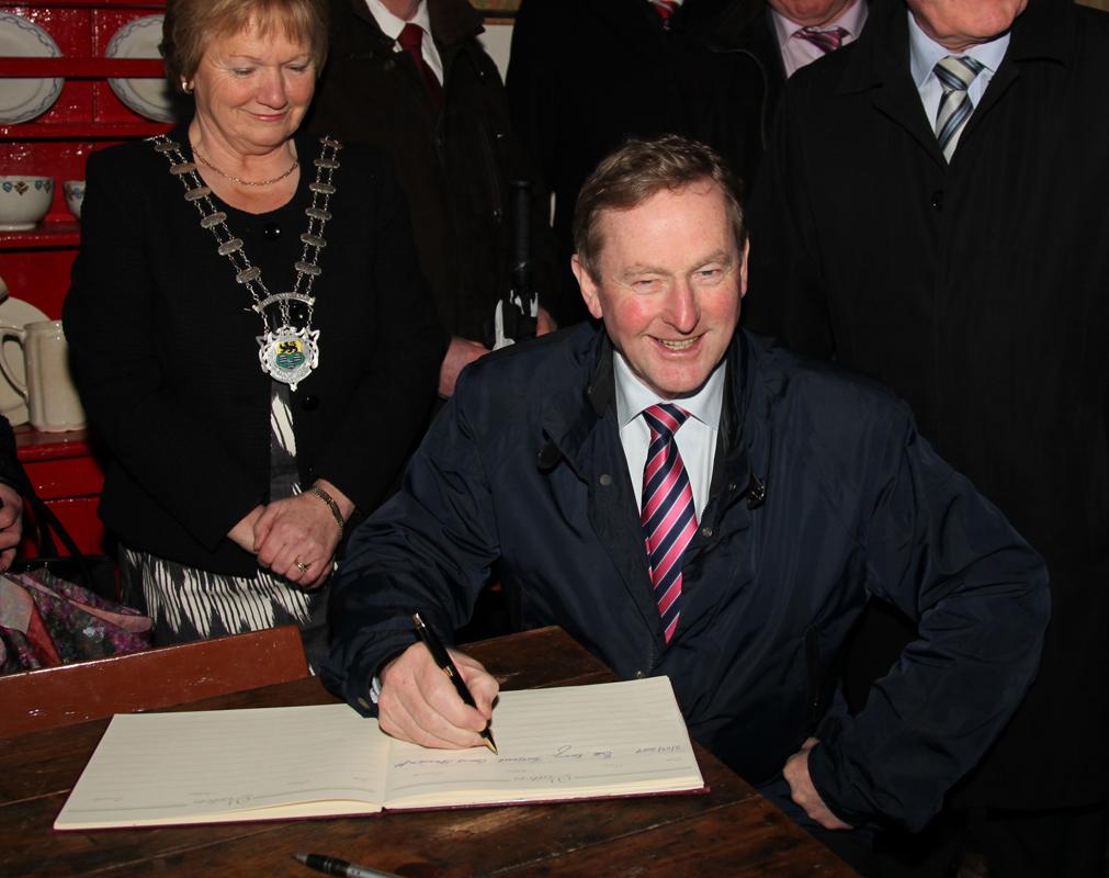 An Taoiseach Enda Kenny signing Visitors book in Sean Mac Diarmada's house