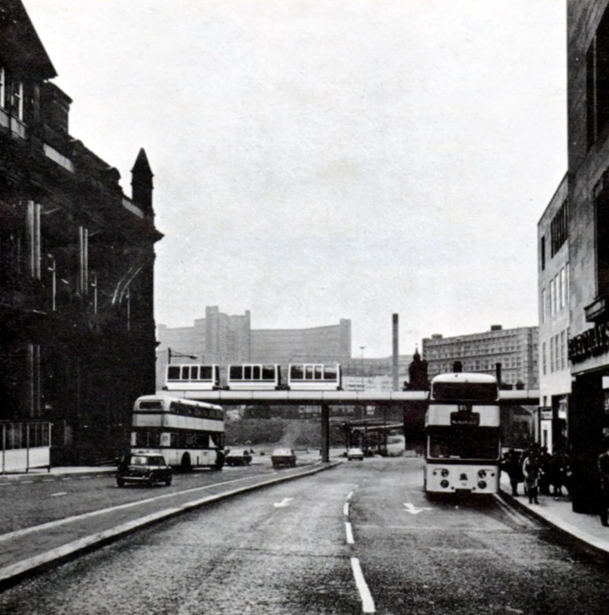 Mock-up of Sheffield Minitram Monorail passing Commercial Street