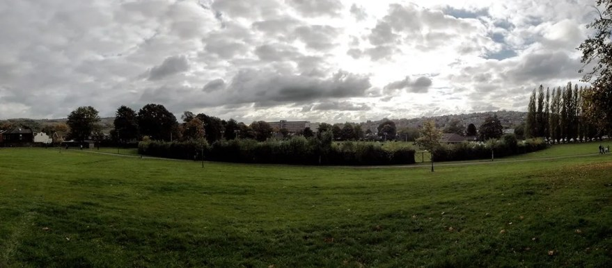 Hillsborough Park, looking over Hillsborough Arena towards Regents Court flats