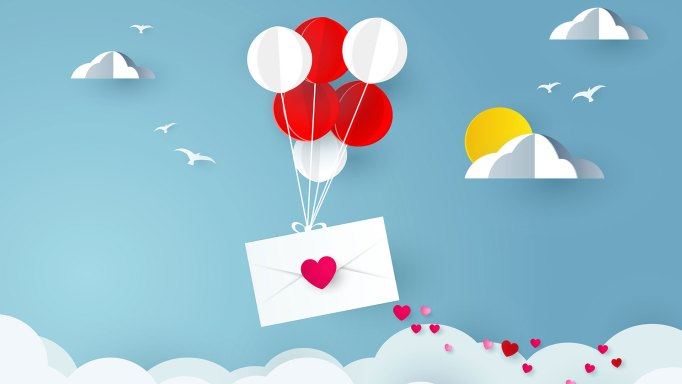 Love letter being delivered by balloons.