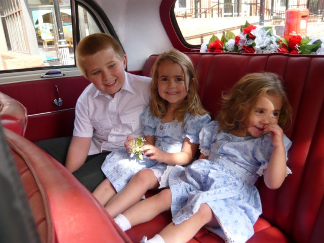 Aiden, Kaycee and Ella in the wedding car at James and Kirsty's wedding