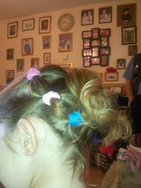 Ella's hair tied up for sports day