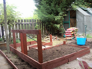 Rain stopped play yesterday. We'd nearly got the raised beds filled with soil