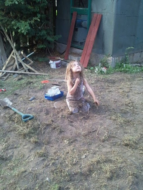 Putting soil all over herself kept her amused for a very long time!