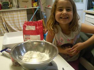 KayCee measuring ingredients for millionaire's shortbread