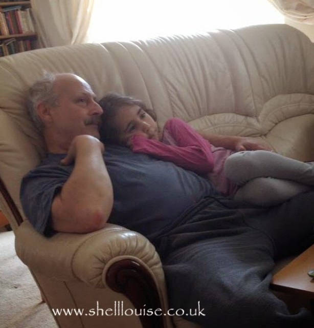 Silent Sunday photo - Ella and daddy having snuggles while watching TV