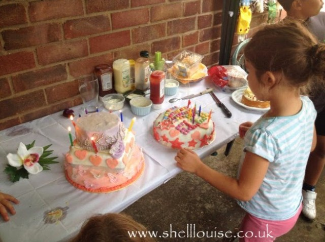 Ella looking at her birthday cake