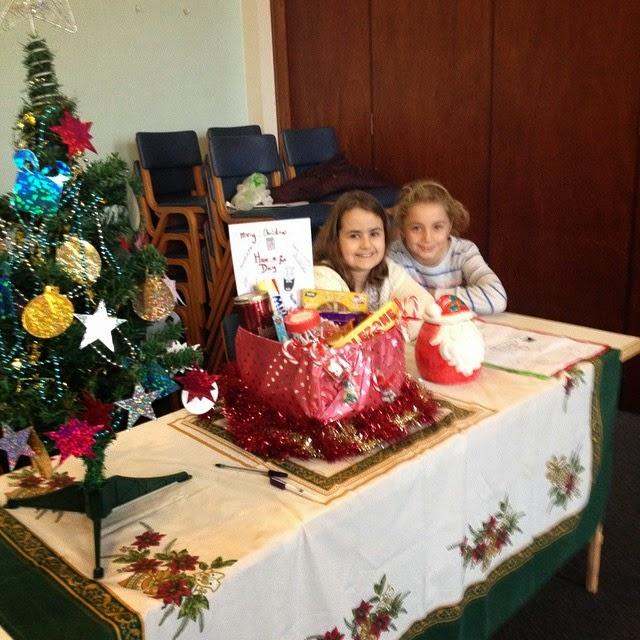 Christmas raffle - KayCee & Emma running their stall at Guides