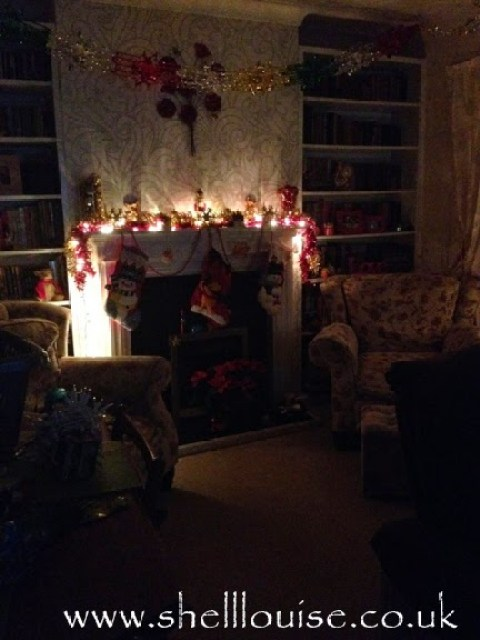The fireplace lit-up at night