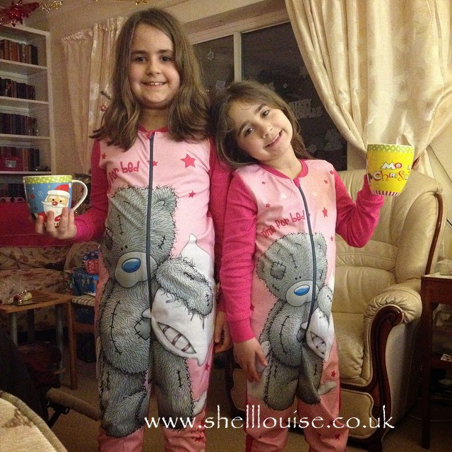 Kaycee and Ella in new onesies and with new Christmas mugs - Christmas Eve photos