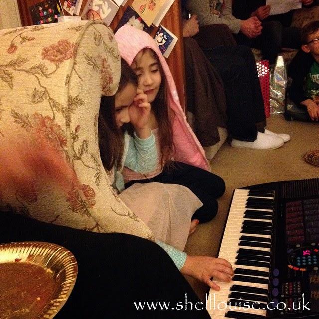 Kaycee and Ella giving a piano concert - Christmas Eve photos